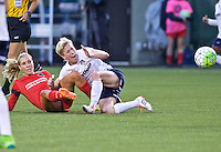 Portland, Oregon - Saturday May 21, 2016: The Portland Thorns Allie Long,(10) and Washington Spirits Joanna Lohman (15) during a regular season NWSL match at Providence Park. The Thorns won 4-1.