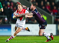 Picture by Alex Whitehead/SWpix.com - 16/03/2018 - Rugby League - Betfred Super League - St Helens v Leeds Rhinos - Totally Wicked Stadium, St Helens, England - St Helens' James Roby is tackled by Leeds' Brett Delaney.
