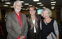 NWA Democrat-Gazette/CARIN SCHOPPMEYER Charles and Evelyn Jorgenson, Northwest Arkansas Community College president (from left) visit with Janet Hendren, NWACC foundation board member at at the college's holiday reception Dec. 6 at the Shewmaker Center for Health Professions in Bentonville.