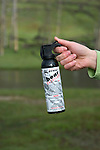 WY: Wyoming; Yellowstone National Park:.Bear spray, pepper, uses for protection against bears..Photo #: yellow1472.Photo copyright Lee Foster, 510/549-2202, lee@fostertravel.com, www.fostertravel.com..