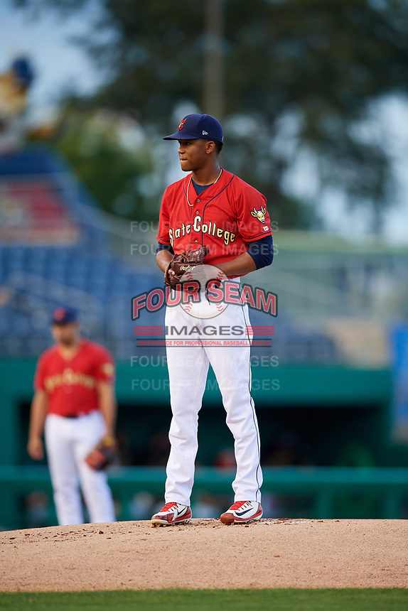 State College Spikes starting pitcher Diego Cordero (11) looks in for the sign during a game against the West Virginia Black Bears on August 30, 2018 at Medlar Field at Lubrano Park in State College, Pennsylvania.  West Virginia defeated State College 5-3.  (Mike Janes/Four Seam Images)