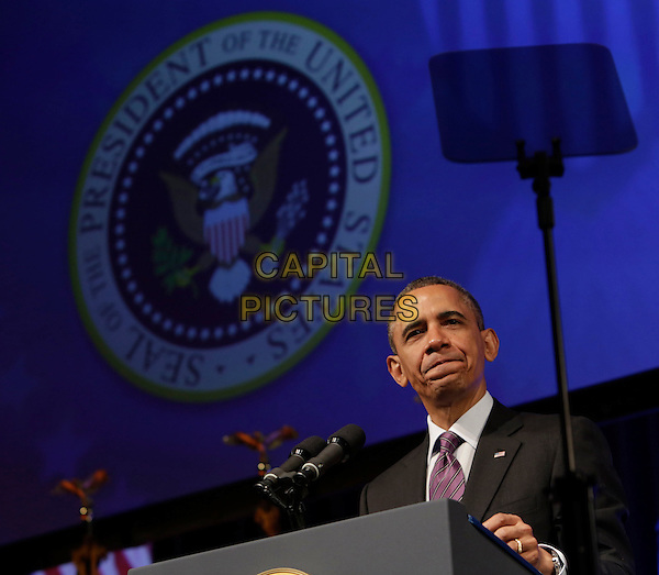 Barack Obama.United States President Barack Obama speaking at the Planned Parenthood Gala at the Washington Marriott Wardman Park Hotel in Washington, DC, USA, April 26, 2013..portrait headshot podium American flags  suit tie speaking purple politics microphone .CAP/ADM/CNP/CK.©Chris Kleponis/AdMedia/Capital Pictures