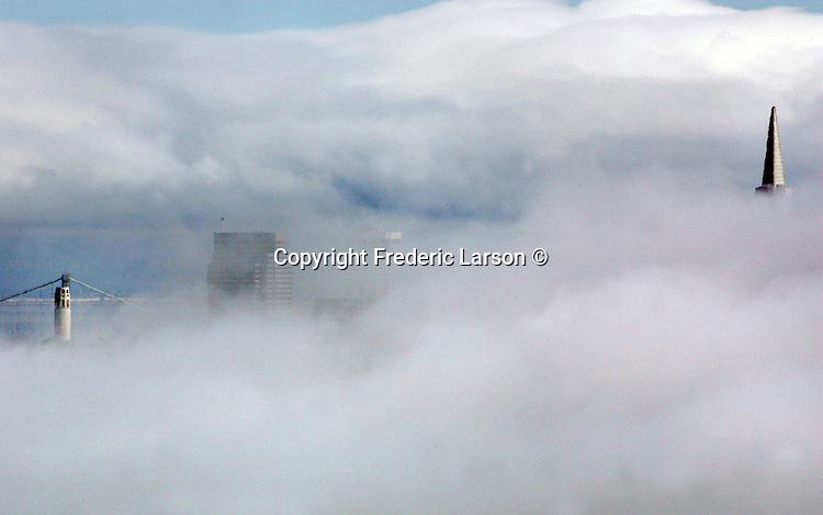 Summer like San Francisco fog blanketed the city on the first day of October as just the tips of the tallest building appeared from Marin Headlands.