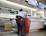 January 24, 2017, Narita, Japan - All Nippon Airways (ANA) ground staff wearing a robot suit Hybrid Assistive Limb (HAL), developed by Tsukuba University professor Yoshiyuki Sankai and Cyberdyne demonstrates to carry a heavy baggage at the ANA check-in counter as airline companies started their field tests of HAL at the Narita International Airport in Narita, suburban Tokyo on Tuesday, January 24, 2017. The HAL is designed to learn the user's motion and assist their movements, can be used by workers to reduce strain on carrying heavy objects by supporting the user's back.   (Photo by Yoshio Tsunoda/AFLO) LWX -ytd-