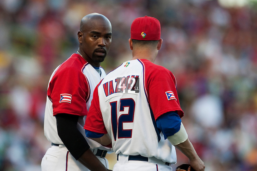 11 March 2009: #21 Carlos Delgado of Puerto Rico talks to #12 Ramon Vazquez during the 2009 World Baseball Classic Pool D game 6 at Hiram Bithorn Stadium in San Juan, Puerto Rico. Puerto Rico wins 5-0 over the Netherlands