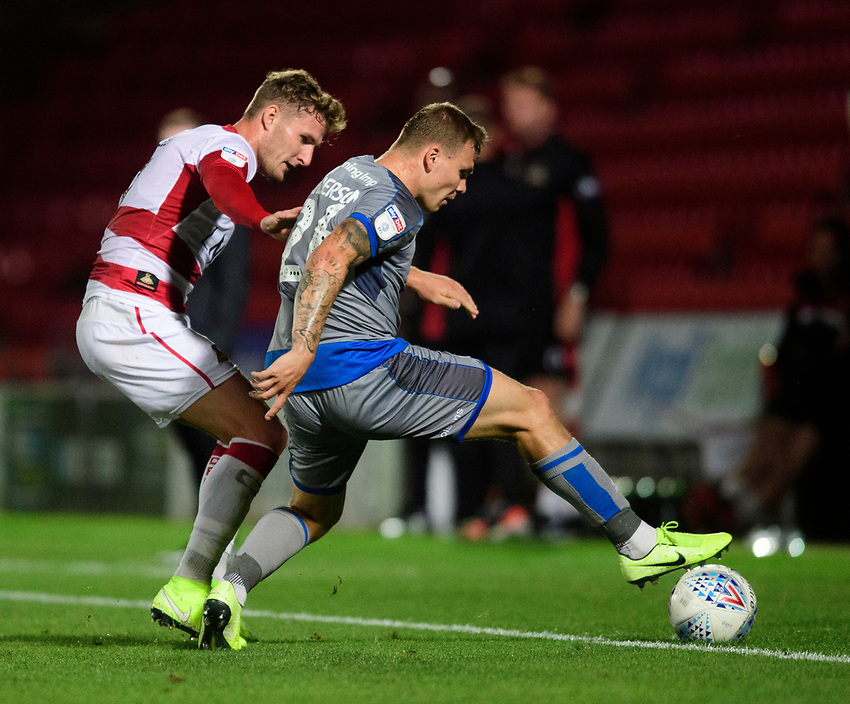 Lincoln City's Harry Anderson vies for possession with Doncaster Rovers' Kieran Sadlier<br /> <br /> Photographer Chris Vaughan/CameraSport<br /> <br /> EFL Leasing.com Trophy - Northern Section - Group H - Doncaster Rovers v Lincoln City - Tuesday 3rd September 2019 - Keepmoat Stadium - Doncaster<br />  <br /> World Copyright © 2018 CameraSport. All rights reserved. 43 Linden Ave. Countesthorpe. Leicester. England. LE8 5PG - Tel: +44 (0) 116 277 4147 - admin@camerasport.com - www.camerasport.com