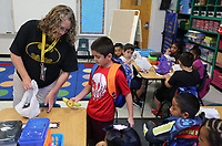 NWA Democrat-Gazette/DAVID GOTTSCHALK Chastity Sherron, a first grade teacher at Lee Elementary School, helps Victor Trochez-Alarcon Tuesday, August 13, 2019, find his seat and have breakfast at the school in Springdale. Tuesday was the first day of the school year for the Springdale School District.