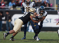 Brendan Bigelow of California runs the ball during the game against Colorado at Folsom Field in Boulder, Colorado on November 16th, 2013.  Colorado defeated California, 41-24.