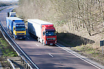 Volvo heavy goods vehicles on A12 trunk road in Suffolk, England