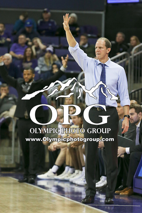 SEATTLE, WA - DECEMBER 17: Washington head coach Mike Hopkins directs his team from the bench against Loyola Marymount.  Washington won 80-77 over Loyola Marymount at Alaska Airlines Arena in Seattle, WA.  (Photo by Jesse Beals/Icon Sportswire