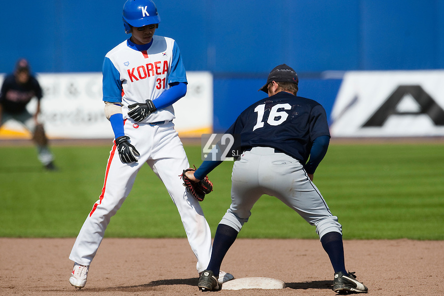 14 September 2009: Jong-Wook Ko of South Korea is safe at second base as Samuel Wiley tags him during the 2009 Baseball World Cup Group F second round match game won 15-5 by South Korea over Great Britain, in the Dutch city of Amsterdan, Netherlands.