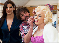BNPS.co.uk (01202 558833)<br /> Pic: PhilYeomans/BNPS<br /> <br /> Mike applys the final touches to Marilyn Monroe.<br /> <br /> Tinseltown comes to Dorset - Wax artist Michael Wade is surrounded with a surreal who's who of Hollywood stars in the unlikely surrounds of his Bridport studio.<br /> <br /> Michael has just completed a bumper order of silver screen idols for a new museum in America. His tiny studio is now home to John Wayne, Humphrey Bogart and Elvis as well as Sandra Bullock, Jennifer Aniston and even Marylin Monroe.<br /> <br /> Each work takes 3 months to create with a sculptor first creating the head before thousands of real hairs are individually inserted, next a hairdresser cuts and crimps, teeth made by a dentist are added along with bespoke eyes created by NHS technicians. <br /> <br /> After all this careful work Michael takes the waxwork to a dress maker to tailor a suitable outfit and then the stunning &pound;20,000 models are complete.