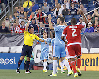 Foxborough, Massachusetts - July 18, 2015: In a Major League Soccer (MLS) match, the New England Revolution (red) defeated New York City FC (blue), 1-0, at Gillette Stadium.Red card to Ned Grabavoy.