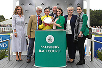 Jockey of Kenzai Warrior, Jason Watson receives his trophy for winning The Irish Thoroughbred Marketing Novice Stakes during Racing at Salisbury Racecourse on 5th September 2019