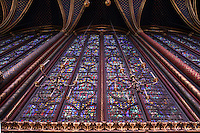 View from below of the stained glass clerestories, nave of the Upper chapel of La Sainte-Chapelle (The Holy Chapel), 1248, Paris, France. Fifteen huge mid-13th century windows fill the nave and apse. Each window group has four lancets topped by three rose windows. La Sainte-Chapelle was commissioned by King Louis IX of France to house his collection of Passion Relics, including the Crown of Thorns. The Sainte-Chapelle is considered among the highest achievements of the Rayonnant period of Gothic architecture. Picture by Manuel Cohen