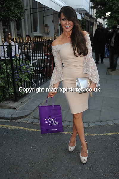 NON EXCLUSIVE PICTURE: MATRIXPICTURES.CO.UK<br /> PLEASE CREDIT ALL USES<br /> <br /> WORLD RIGHTS<br /> <br /> English presenter Lizzie Cundy attending the Amy Childs Summer fashion launch at West London's Beach Blanket Babylon.<br /> <br /> JUNE 6th 2016<br /> <br /> REF: TST 161724