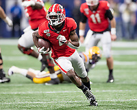 ATLANTA, GA - DECEMBER 7: George Pickens #1 of the Georgia Bulldogs runs after a reception during a game between Georgia Bulldogs and LSU Tigers at Mercedes Benz Stadium on December 7, 2019 in Atlanta, Georgia.