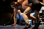 LA CROSSE, WI - MARCH 11: Coaches watch Dustin Weinmann of Wisconsin-La Crosse tangle up with Cross Cannone of Wartburg in the 141 weight class during NCAA Division III Men's Wrestling Championship held at the La Crosse Center on March 11, 2017 in La Crosse, Wisconsin. Weinmann beat Cannone 4-0 to win the National Championship. (Photo by Carlos Gonzalez/NCAA Photos via Getty Images)