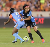 Houston Texas - Chioma Ubogagu (9) of the Houston Dash battles Samantha Johnson (16) of the Chicago Red Stars for the ball in the second half on Saturday, April 16, 2016 at BBVA Compass Stadium in Houston Texas.  The Houston Dash defeated the Chicago Red Stars 3-1.