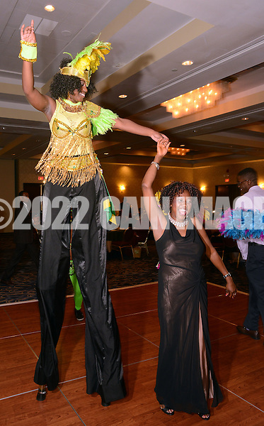 G1FUNN12C<br /> Stilt walker Tanaya Thomas of Soca Fitness Caribbean Dance dances with Grace Nnadiugwu of Nigeria during the FunTimes Magazine 5th Annual Gala Saturday October 10, 2015 at the Renaissance Hotel in Philadelphia, Pennsylvania. The event featured a dinner dance as well as the recipients of three awards. (William Thomas Cain/For The Inquirer)