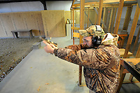 NWA Media/ J.T. Wampler - Wilson Combat test shooter Casey Combs shoots a CQB Full size .45 Wednesday Dc. 17, 2014. Each firearm is shot 80-90 times before it ships to a customer.
