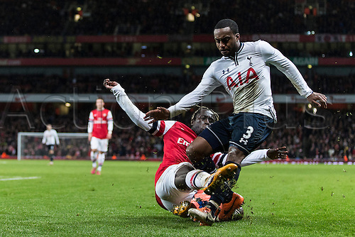 04.01.2014 London, England.  Arsenal defender Bacary SAGNA tackles Tottenham's Danny ROSE during the FA Cup 3rd Round game between Arsenal and Tottenham Hotspur from the Emirates Stadium.
