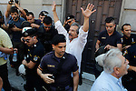 """Demonstrators from the Greek Communist party scuffle with riot police outside of the offices of """"Federation of Greek Industries"""". The battle for Greek votes entered full swing Friday ahead of a crucial weekend referendum that could decide whether the country falls out of the euro."""