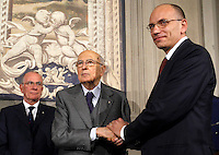 Il Presidente del Consiglio incaricato Enrico Letta stringe la mano al Capo dello Stato Giorgio Napolitano, a sinistra, dopo aver presentato la lista dei ministri del suo nuovo governo, al Quirinale, Roma, 27 aprile 2013..Italian Premier designate Enrico Letta shakes hands with the Head of State Giorgio Napolitano, left, after presenting the list of ministers of his new government, at the Quirinale presidential palace in Rome, 27 April 2013..UPDATE IMAGES PRESS/Isabella Bonotto