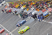 A busy pit road as race cars make pit stops during the Gatorade Dual 150 qualifying races for the Daytona 500 at Daytona International Speedway, Daytona Beach, FL, February 11, 2010.  (Photo by Brian Cleary/www.bcpix.com)