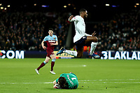 29th January 2020; London Stadium, London, England; English Premier League Football, West Ham United versus Liverpool; Lukasz Fabianski of West Ham United collects the ball from Georginio Wijnaldum of Liverpool