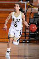 9 January 2010:  FIU's Michelle Gonzalez (5) handles the ball in the second half as the Troy Trojans defeated the FIU Golden Panthers, 61-59, at the U.S. Century Bank Arena in Miami, Florida.