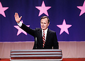 United States Vice President George H.W. Bush waves to the crowd from the podium as he delivers his speech accepting his party's nomination for President of the United States at the 1988 Republican Convention at the Super Dome in New Orleans, Louisiana on August 18, 1988.<br /> Credit: Howard L. Sachs / CNP