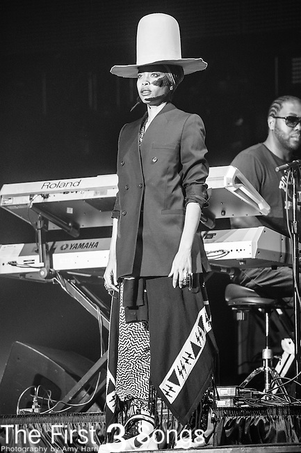 Erykah Badu performs at the 2014 Essence Festival at the Mercedes-Benz Superdome in New Orleans, Louisiana.
