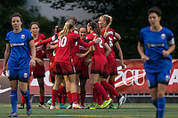 Seattle, WA - Saturday, May 14, 2016: Portland Thorns FC forward Nadia Nadim (9) celebrates scoring with teammates  including midfielder Allie Long (10), defender Katherine Reynolds (2), and midfielder Dagny Brynjarsdottir (11). The Portland Thorns FC and the Seattle Reign FC played to a 1-1 tie during a regular season National Women's Soccer League (NWSL) match at Memorial Stadium.