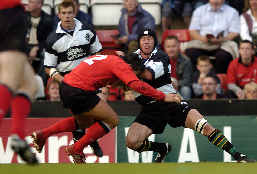 Photo: Richard Lane..Barbarians v Wales at Ashton Gate, Bristol. 26/05/2004..Bruce Reihana is tackled by Gavin Henson.
