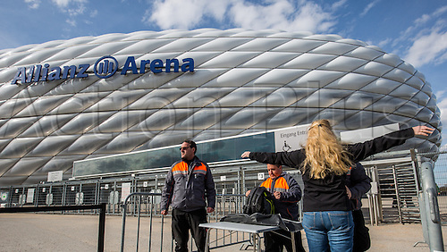 29.03.2016. Munich, Germany.  Security staff check spectators before entry into the stadium, for the international soccer  match between Germany and Italy, at the Allianz Arena in Munich, Germany, 29 March 2016.