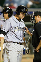 Omaha Storm Chaser catcher Manny Pina argues with the home plate umpire in a game against the Round Rock Express in Pacific Coast League baseball on Monday April 11th, 2011 at Dell Diamond in Round Rock Texas.  (Photo by Andrew Woolley / Four Seam Images)