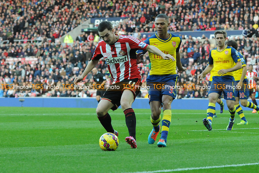 Adam Johnson of Sunderland battles with Kieran Gibbs of Arsenal - Sunderland AFC vs Arsenal - Barclays Premier League Football at the Stadium of Light, Sunderland - 25/10/14 - MANDATORY CREDIT: Steven White/TGSPHOTO - Self billing applies where appropriate - contact@tgsphoto.co.uk - NO UNPAID USE