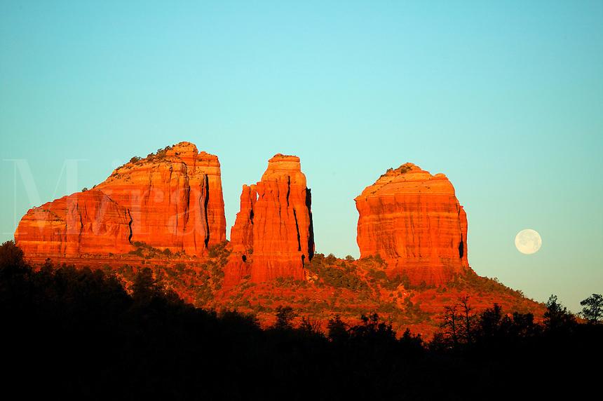 Full moon and sunrise light on Cathedral Rock, Sedona, Arizona.