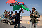 Mcc0030300 . Daily Telegraph..Libyan rebel fighters near the wealthy oil town of Ras Lanuf, which Libyan government forces retreated from last night..Gaddafi's have been on forced retreat since saturday night due to repeated attacks from NATO airstrikes...Ras Lanuf 27 March 2011