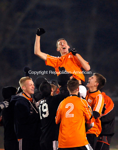 Waterbury, CT- 03, November 2010-110310CM04  The Watertown boys soccer team hoist up teammate, Kylee Lecchi during their celebration after defeating Naugatuck for the NVL title Wednesday night at Municipal Stadium in Waterbury.  They defeated the Greyhounds, 2-1. Christopher Massa Republican-American
