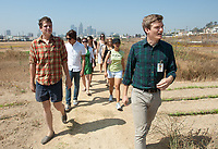 Tom Carroll '08 (green shirt) leads a group through what is now called the Los Angeles State Historic Park. Freshmen participate in OxyEngage, which are trips that introduce students to some of the local sights. This trip was part of an art-themed trip, which took them to places like Not a Corn Field. August 21, 2008, Los Angeles, Calif. (Photo by Marc Campos, College Photographer)