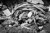 Goma, Zaire<br /> July 1994<br /> <br /> Dead ethnic Rwandan Hutu civilians are dumped into a mass grave in Zaire. <br /> <br /> Following the 1994 Rwandan Genocide, in which Hutu militia groups and the Hutu lead Rwanda military, killed an estimated 800,000 ethnic Tutsis and sympathizers during a 100-day killing spree, 2 million ethnic Hutu&rsquo;s, fearing reprisals, flee the country. The vast majority went to Goma, Zaire as tens of thousands died in epidemics of cholera and dysentery that swept the roadside crowds and refugee camps. People who had actively participated in the genocide hid among the refugees, fueling the First and Second Congo Wars.<br /> <br /> The international community, and the United Nations in particular, drew severe criticism for its inaction in the wake of the Rwandan Genocide.
