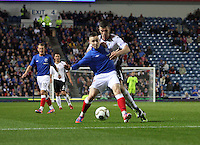 Barrie McKay being pressured by Mark Durnan in the Rangers v Queen of the South Quarter Final match in the Ramsdens Cup played at Ibrox Stadium, Glasgow on 18.9.12.