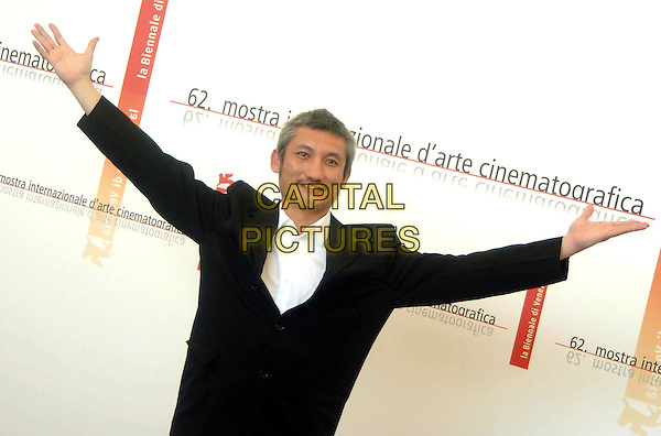 "TSUI HARK.Photocall of the film ""Seven Swords"",.62nd International Film Festival,.Venice, 31st August 2005.portrait headshot movie black jacket white shirt grey gray goatie beard mustache hand arms.www.capitalpictures.com.sales@capitalpictures.com.© Capital Pictures."