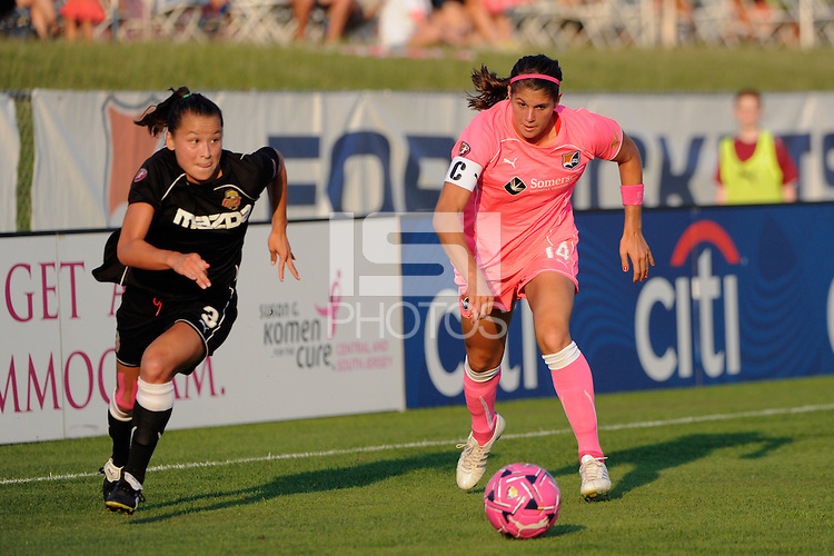 Brittany Taylor (14) of Sky Blue FC is defended by Ali Riley (3) of the Western New York Flash. The Western New York Flash defeated Sky Blue FC 2-0 during a Women's Professional Soccer (WPS) match at Yurcak Field in Piscataway, NJ, on July 17, 2011.