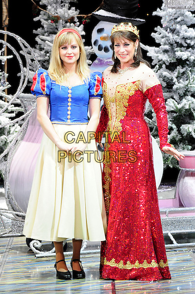 TINA O'BRIEN & DINA PAYNE.First Family Entertainment theatre company's annual group Pantomime photocall at Piccadilly Theatre, London, England..November 26th, 2010.stage costume panto pantomime full length red yellow blue dress snow white crown queen .CAP/CAS.©Bob Cass/Capital Pictures.