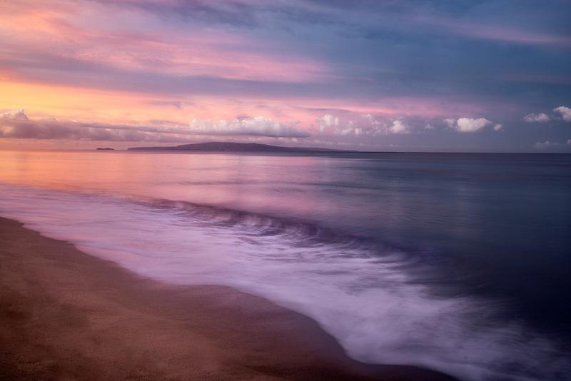 Shoreline and sunrise. with Kaho'olehu Island. Maui, Hawaii