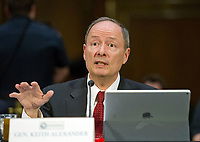 """United States Army General (Retired) Keith B. Alexander, former Director, National Security Agency (DIRNSA), former Chief of the Central Security Service (CHCSS) and former Commander of the United States Cyber Command, and current Chief Executive Officer and President, IronNet Cybersecurity, makes his opening statement as he testifies before the US Senate Select Committee on Intelligence conducting an open hearing titled """"Disinformation: A Primer in Russian Active Measures and Influence Campaigns"""" on Capitol Hill in Washington, DC on Thursday, March 30, 2017. Photo Credit: Ron Sachs/CNP/AdMedia"""