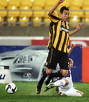 Phoenix' Diego Walsh is tackled by Adriano Pellegrino during the A-League football match between Wellington Phoenix and Perth Glory at Westpac Stadium, Wellington, New Zealand on Sunday, 16 August 2009. Photo: Dave Lintott / lintottphoto.co.nz